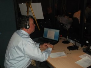 Philippe Vitu interpreting in a booth at a recent conference in Montreal.